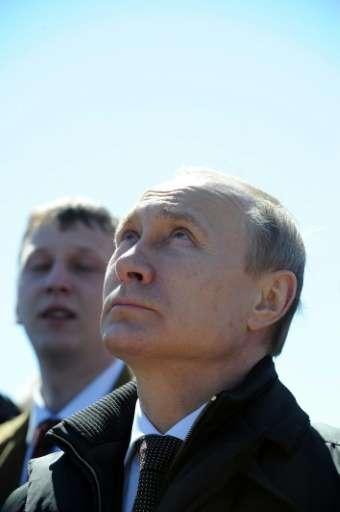 Russian President Vladimir Putin watches the launch of a Soyuz 2.1a rocket, carrying Lomonosov, Aist-2D and SamSat-218 satellite