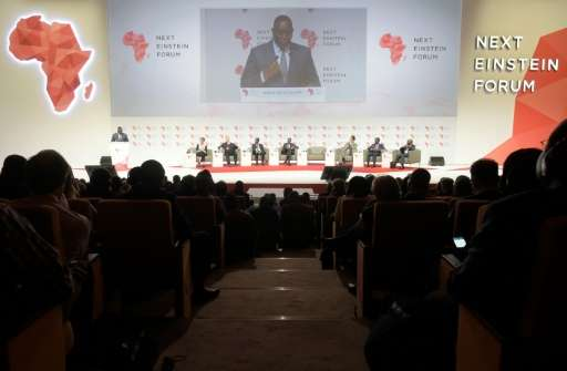 """Senegalese President Macky Sall (L) delivers a speech in Dakar, during the opening of the """"Next Einstein Forum"""" (NEF)"""