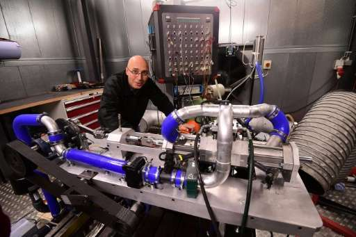 Shaul Yakobi, inventor and co-founder of Aquarius Engines, poses next to a single piston combustion engine invented by the firm