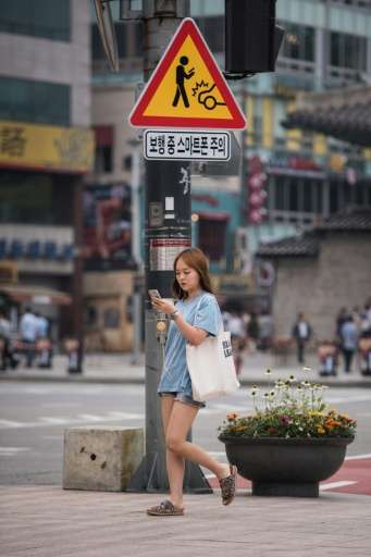 South Korean smartphone users spend an average of four hours a day tweeting, chatting or playing games, with about 15 percent sh