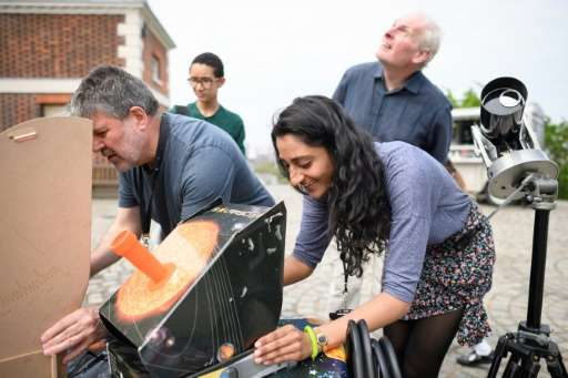 Stargazers set up to watch Mercury moving across the face of the sun at the Royal Observatory in Greenwich on May 9, 2016