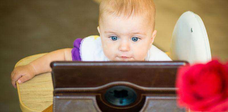 Tablets at the table can influence child development, not always in a good way
