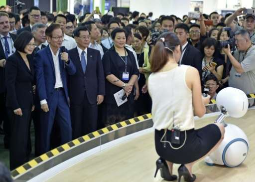The Asus Zenbo robot steals the show as it serenades Taiwan's President Tsai Ing-wen (L) at the Computex computer exhibition on