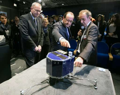 The National Centre for Space Studies (CNES) president Jean-Yves Le Gall (L), French President Francois Hollande and French astr