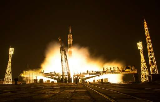 The Soyuz MS-03 spacecraft is seen launching from the Baikonur Cosmodrome with Expedition 50 crewmembers NASA astronaut Peggy Wh