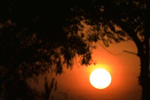 The sun rises over Jakarta, Inodnesia on March 9, 2015