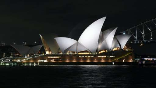 The Sydney Opera House pictured on March 19, 2016 before the lights were turned off for the Earth Hour campaign
