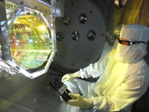 This image, taken December 14, 2015, shows a Laser Interferometer Gravitational Wave Observatory (LIGO) optics technician inspec