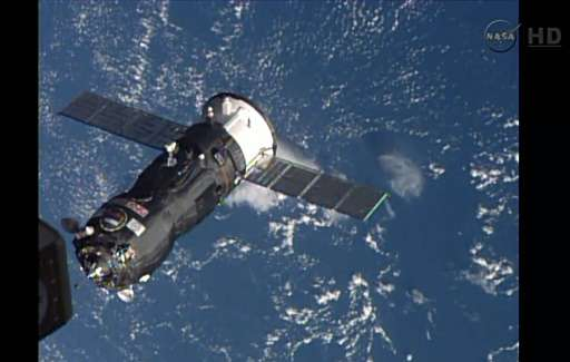 This October 29, 2014 image taken from NASA TV shows the Russian Progress 57 Cargo Ship arriving to dock with the International