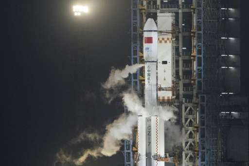 A Long March 7 orbital launch vehicle carrying China's cargo spacecraft Tianzhou-1 shortly before lift off at the Wenchang Space
