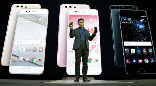 Chinese multinational networking and telecommunications equipment and services company Huawei's CEO Richard Yu presents e Huawei