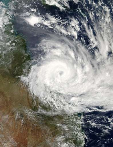 Cyclone Debbie is expected to cross the Queensland state coast as a category four storm—on a scale of five—packing destructive w