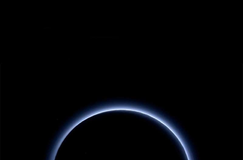 Pluto's hydrocarbon haze keeps dwarf planet colder than expected