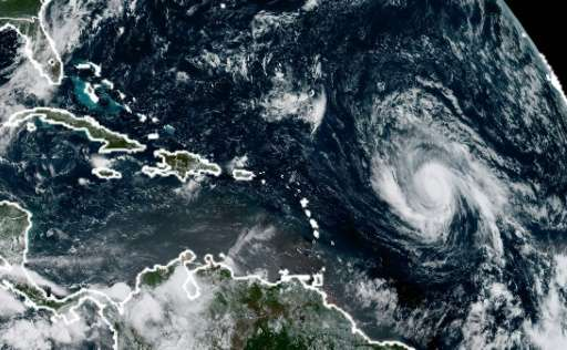This image obtained from the National Oceanic and Atmospheric Administration shows Huricane Irma (R) on September 3, 2017