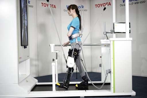 Toyota shows robotic leg brace to help paralyzed people walk