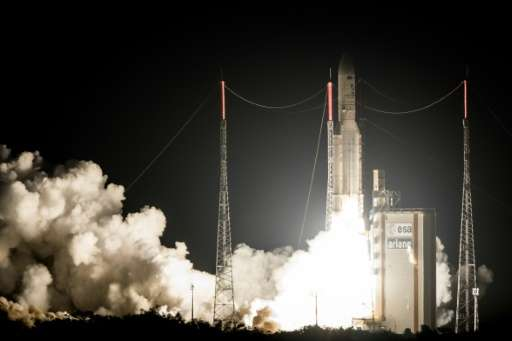 An Ariane 5 rocket carrying Brazilian and South Korean satellites lifts off from the European space centre in French Guiana on M