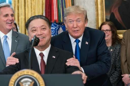 Broadcom CEO Hock Tan, seen at a November 2 White House meeting with President Donald Trump, has stepped up efforts to win a $13