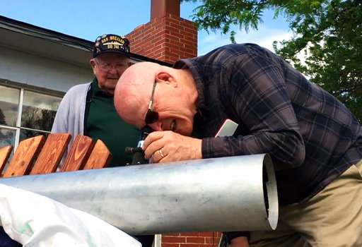 Father, son prepare for eclipse after missed 1979 viewing
