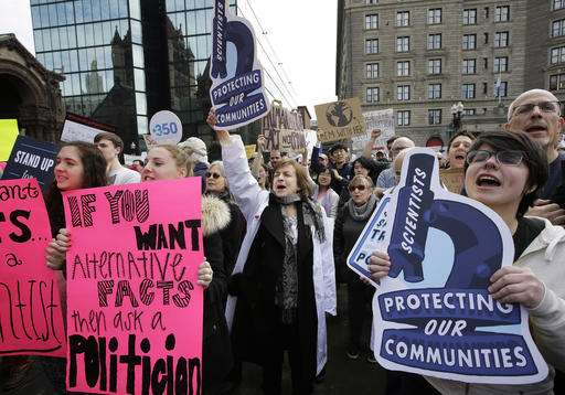 Scientists hold rally in Boston protest threats to science