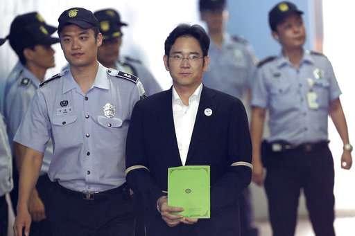 South Korean court sentences Samsung heir to 5 years prison