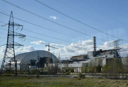 This photo taken on April 22, 2016 shows the 4th block of Chernobyl's Nuclear Power Plant (R) and Chernobyl's New Safe Confineme