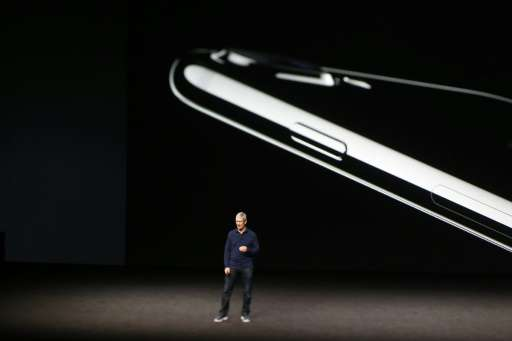 Apple CEO Tim Cook, seen at the 2016 unveiling of the iPhone 7, is expected to announce updated versions of the smartphone at an