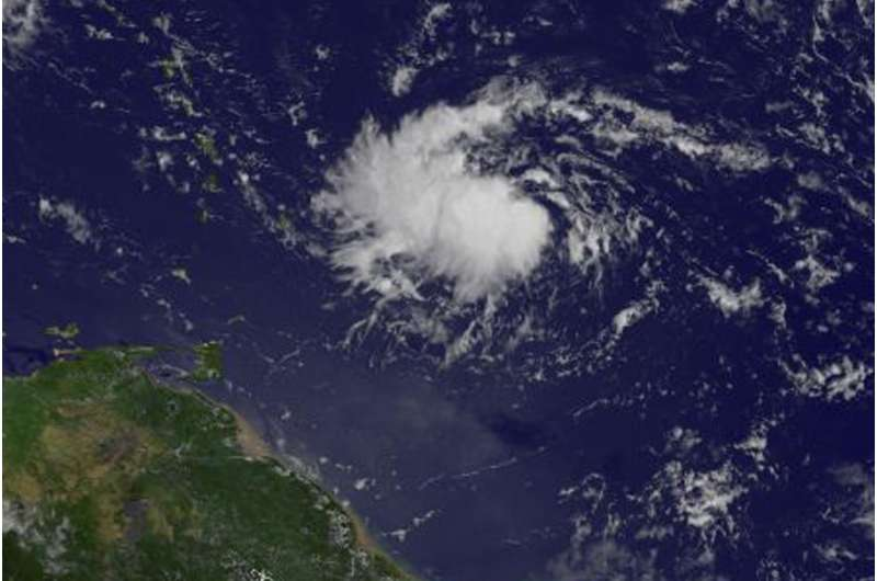 NASA sees Tropical Depression 9 form east of Lesser Antilles