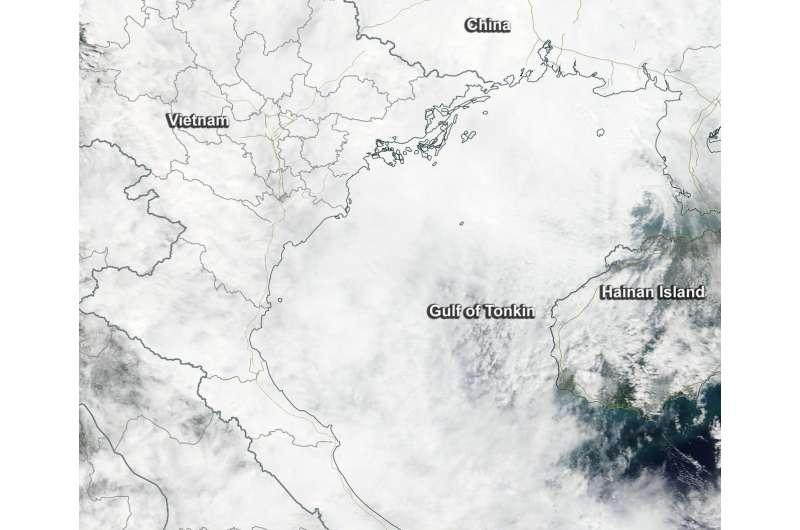 NASA sees Tropical Depression Khanun sissipating in Gulf of Tonkin