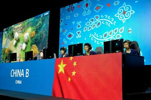 Members of the Chinese eSports team compete in the eSports tournament at the Asian Indoor and Martial Arts Games in Turkmenistan