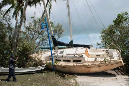 A boat sits in a park after being beached by storm surge from Hurricane Irma in Coconut Grove, Florida