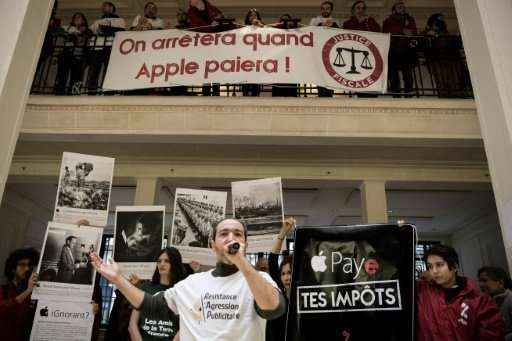 About a hundred activists occupied a two-level Apple store in the centre of Paris, demanding that the US tech giant pay an EU ta