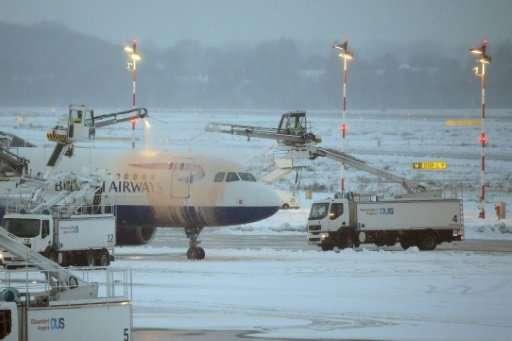 A British Airways plane being de-iced in Duesseldorf airport
