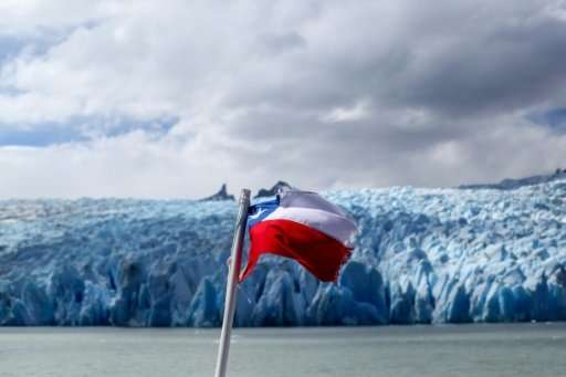 A Chilean flag flutters in the wind near the Grey glacier at the Torres del Paine National Park in far southern Chile