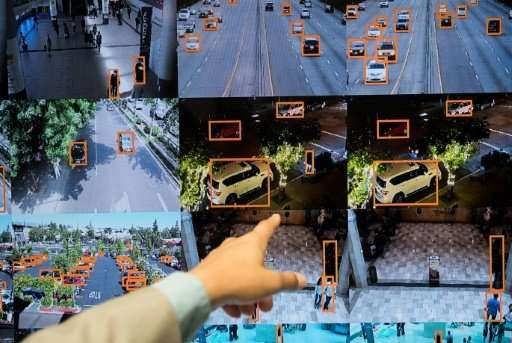 A display shows a vehicle and person recognition system for law enforcement during the NVIDIA GPU Technology Conference, which s