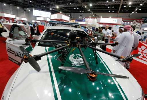 A drone equipped with cameras on a police car at the Gitex Technology week in Dubai