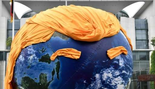 A giant balloon of the Earth with a haircut alluding to US President Donald Trump is seen during a protest in June 2017