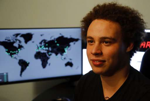 AP Interview: Surfer worked from bedroom to beat cyberattack