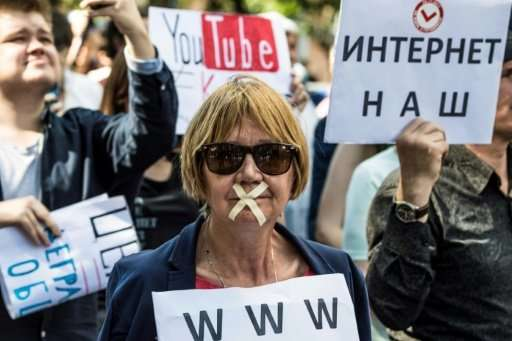 A protester with tape covering her mouth takes part in the March for Free Internet in central Moscow in July.