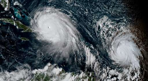 A satellite image showing Hurricane Irma (left) and Hurricane Jose which is following in its path