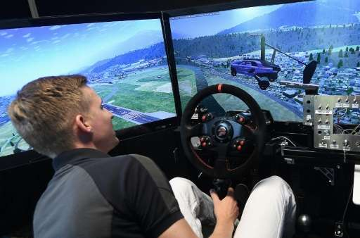 A simulator demonstrates the PAL-V flying car, which can fly 400 to 500 kilometres (248 to 310 miles) at an altitude of up to 3,