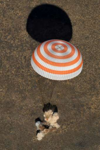 A Soyuz MS-02 capsule brings Russian cosmonauts Sergey Ryzhikov and Andrey Borisenko and US astronaut Shane Kimbrough back home