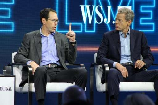AT&T chief executive Randall Stephenson (L) and Time Warner chief executive Jeff Bewkes defend the proposed mega-merger of t