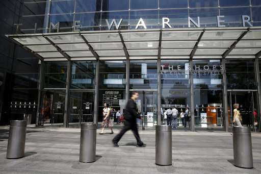 AT&T exec says 'uncertain' when Time Warner deal will close