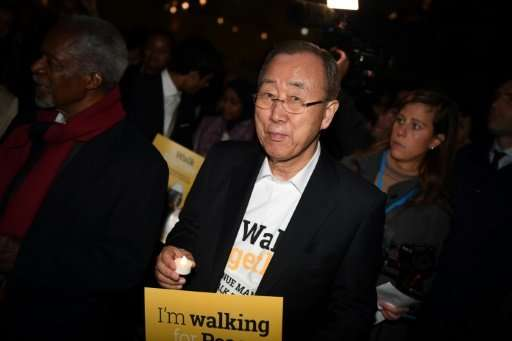 Ban Ki-moon (C), South Korean diplomat and former Secretary-General of the United Nations, is seen leading a procession to Parli