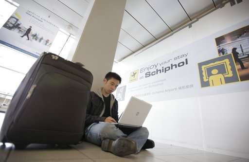 Business, leisure travelers ponder flying without laptops