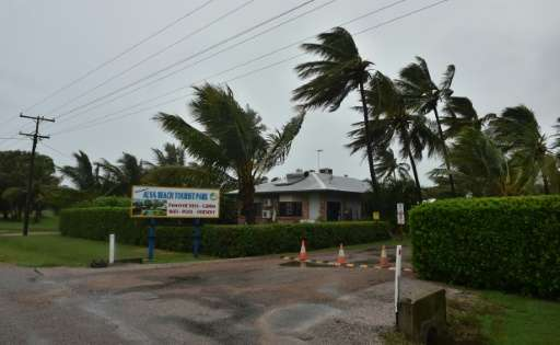 Category four Cyclone Debbie brings lashing rain and howling wind as it batters the town of Ayr
