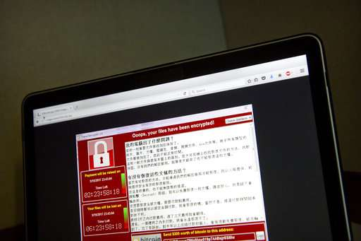 Cyberattack wave ebbs, but experts see risk of more