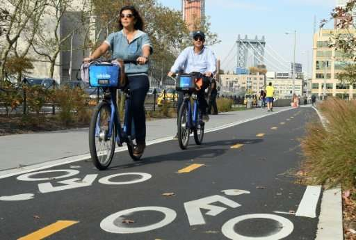 Cyclists use the dedicated bike lanes from the Brooklyn Bridge in New York