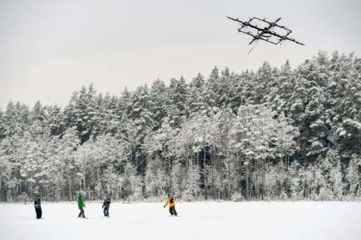 Droneboarders stand on snowboards and grip tow ropes, like those used in water-skiing, and are pulled along by a drone at speeds