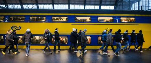 """Eneco and NS said on a joint website that some 600,000 passengers daily are """"the first in the world"""" to travel thanks"""
